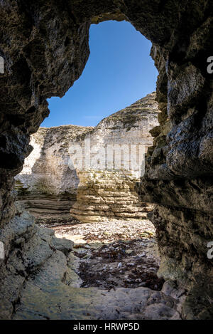 View from a cave in the cliffs at Selwicks bay, Flamborough, North Yorkshire, England. - Stock Photo