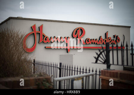 A Harry Ramsden's restaurant sign on the exterior of a building in Bournemouth, Dorset, UK. - Stock Photo