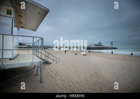 A lifeguard tower on the beach in front of Bournemouth Pier in Bournemouth, Dorset, England, UK. - Stock Photo