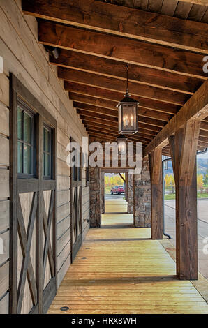 An under the eaves view of a modern timber framed building. - Stock Photo