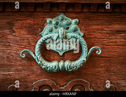 Ornate Brass Door Knocker On A Vintage Wooden Door - Stock Photo