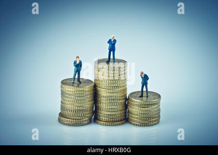 Financial concept. Business people standing on coins piles. Macro photo - Stock Photo