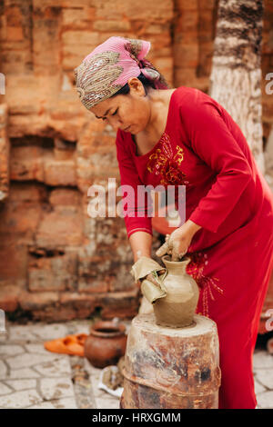 Nha Trang, VIETNAM - CIRCA February 2015 - unidentified woman creates clay pot  traditional handicraft in Vietnam - Stock Photo