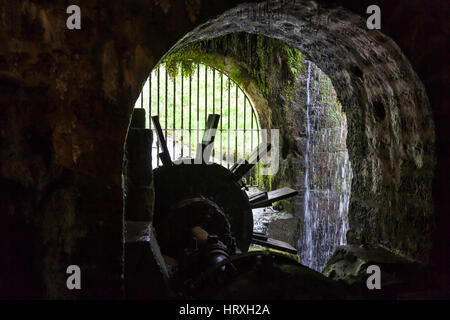 Inside view of the wheel of an old water mill - Stock Photo