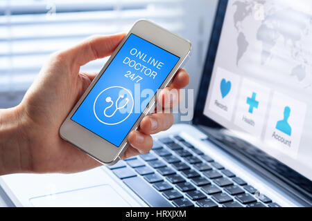Online medical doctor and health care app on mobile phone concept with person showing smartphone screen, remote - Stock Photo