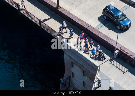 Chicago, USA - May 30, 2016: Aerial view of people walking on DuSable bridge in downtown - Stock Photo
