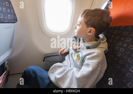 Seven year old boy on-board a easy jet flight, Gatwick airport, England, United Kingdom. - Stock Photo