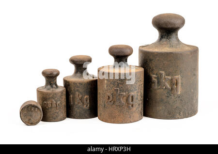 Old and rusty weights on white background - Stock Photo