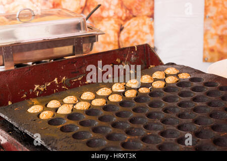 Poffertjes being cooked and sold in a roadside stall in Amsterdam, The Netherlands - Stock Photo