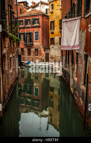 Quiet canal with hanging laundry in a residential area of Venice, Italy - Stock Photo