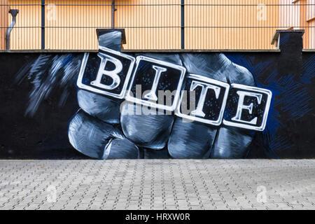 Berlin, Prenzlauer Berg. Mural artwork of black man outside Bite talent management agency in building courtyard - Stock Photo
