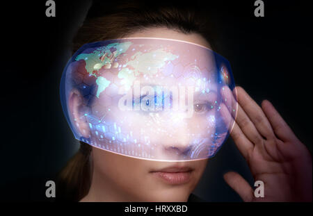 Close-up portrait of young and beautiful woman with the virtual futuristic glasses ( technology concept).Virtual - Stock Photo