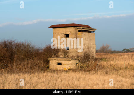 World War One pill box and World War Two look-out tower,  East Lane, Bawdsey, Suffolk, UK. - Stock Photo