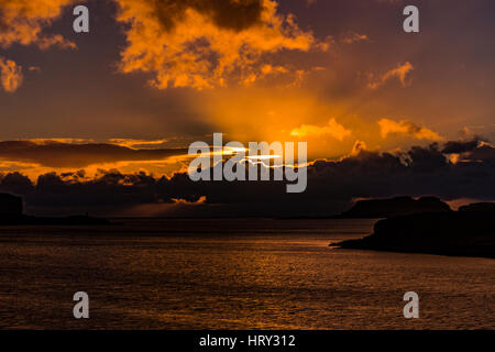 Sunset with crepuscular light across Loch Beag, Isle of Skye, looking out to Ullinish Point, Bracdale Point, Ardtreck Point and Isle Oronsay