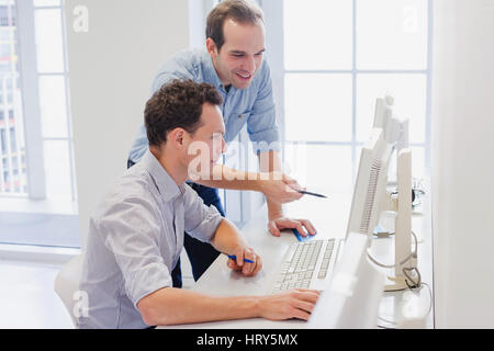 business team working together on computer, businessman discussing project in the office - Stock Photo