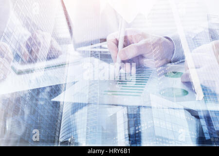 business people working in the office, double exposure of hands closeup, monitoring and analytics - Stock Photo