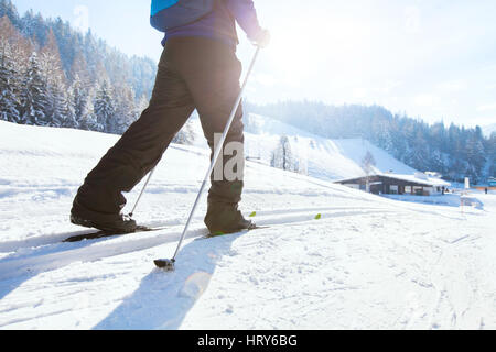 nordic skiing, winter holidays in Alps, cross country skier in mountains - Stock Photo
