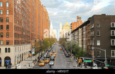 New York, USA - April 27, 2014: Street view on West 23rd Street and London Terrace Towers, apartment building complex, - Stock Photo