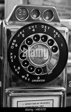 Vintage Rotary Pay Phone - Old Pay Telephone with Coin Slots - Stock Photo