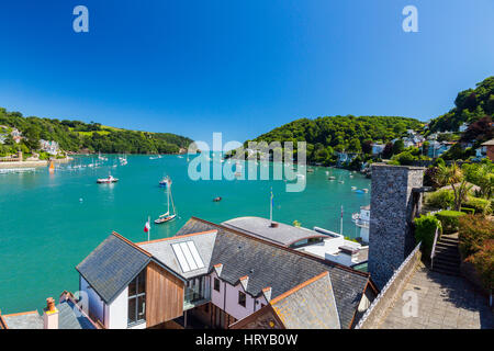 Looking south over some expensive waterfront properties along the River Dart towards its mouth from Dartmouth, Devon, - Stock Photo