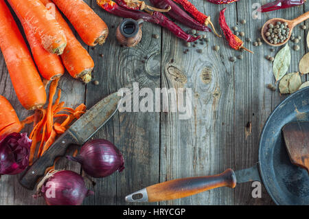 fresh vegetables on the gray wooden surface, empty space in the middle - Stock Photo