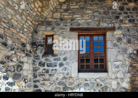 Large and small window in an old basalt wall. - Stock Photo