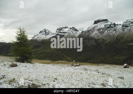 Passo Pordoi: first snow of the season on the Dolomiti mountains, Italy - Stock Photo