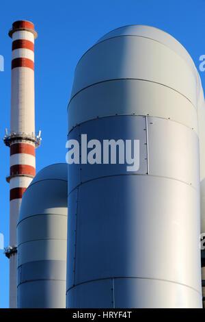 huge pipe in steel factory under blue sky - Stock Photo