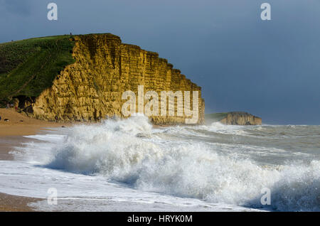 West Bay, Dorset, UK.  5th March 2017.  UK Weather.   Rough seas crash ashore at East Beach at West Bay in Dorset - Stock Photo