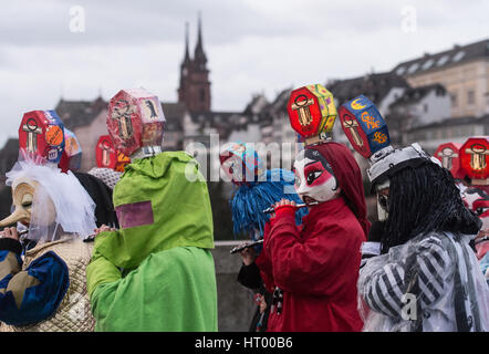 Basel, Switzerland. 6th Mar, 2017. Fools playing instruments parade through the narrow streets of Basel, Switzerland, - Stock Photo