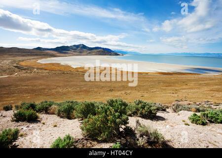 Beautiful view of salty causeway to Antelope Island on Great Salt Lake, Utah, America - Stock Photo