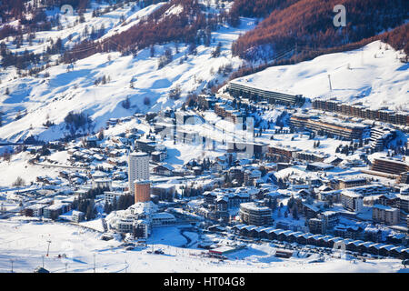 Beautiful panoramic view of Sestriere village, famous ski resort in Piedmont, Italy - Stock Photo