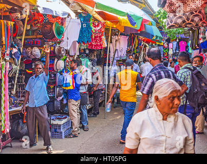 COLOMBO, SRI LANKA - DECEMBER 6, 2016: The narrow rows of clothes department of Pettah market are always crowded - Stock Photo