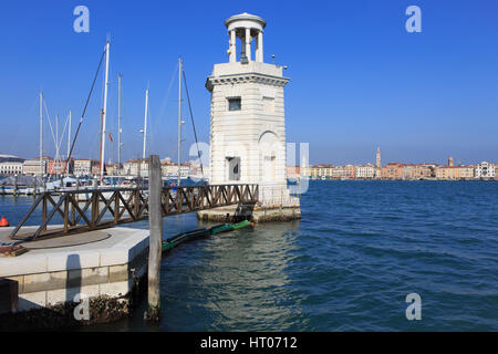The lighthouse of the marina on the island of San Giorgio Maggiore in Venice, Italy - Stock Photo
