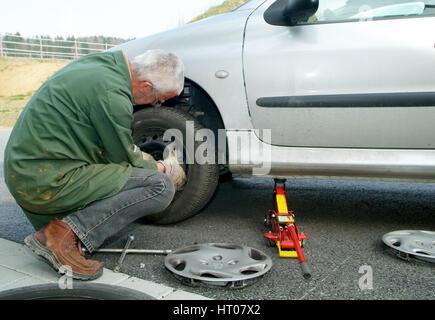 Reifenwechsel - tire change - Stock Photo