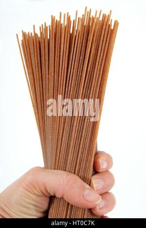 Vollkorn-Spaghetti - wholemeal spaghetti - Stock Photo