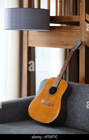 Cozy living room with guitar on the sofa - Stock Photo