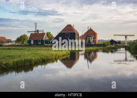 Zaanse Schans with its historic wooden houses, warehouses and windmills is a concept within and outside the Zaanstreek. - Stock Photo