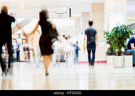 Abstract defocused motion blurred people, walking couple in the shopping center, urban lifestyle concept, background. - Stock Photo