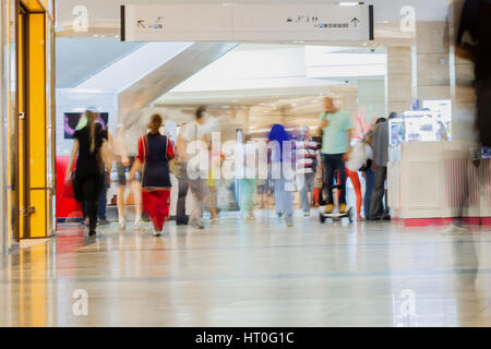 Abstract defocused motion blurred walking young people, active lifestyle in the shopping center, urban lifestyle - Stock Photo