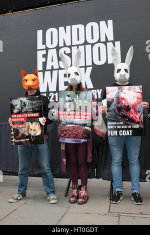 LONDON - FEB 18, 2017: Activists protest against the use of Fur at the Autumn Winter 2017, London Fashion Week showspace - Stock Photo