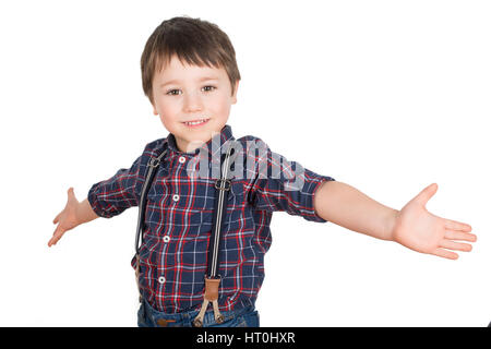 Happy positive young boy smiling with his arms spread out. World is your oyster. Isolated on a white background. - Stock Photo