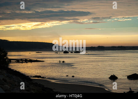 Sunset in Oporto Douro River,  next to Douro Estuary Natural Reserve (Portugal) - Stock Photo