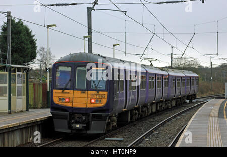 A Northern trains electric train, no 319 368, leaves Euxton Balshaw Lane station with a stopping service from Preston - Stock Photo