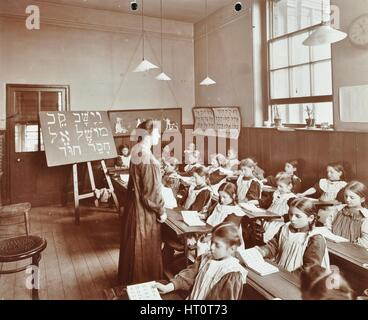 Girls' Hebrew reading lesson, Jews' Free School, Stepney, London, 1908. Artist: Unknown. - Stock Photo
