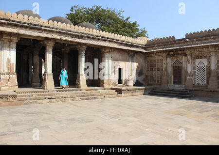 Tourist standing at courtyard at Sarkhej Roza, Makarba, Ahmedabad in Gujarat India. - Stock Photo