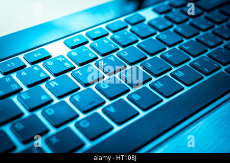 Blue keyboard wirh black keys of computer or laptop - Stock Photo