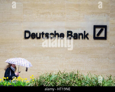 Deutsche Bank London - a woman walk past the London offices of Deutsche Bank in the Square Mile, London's Financial - Stock Photo