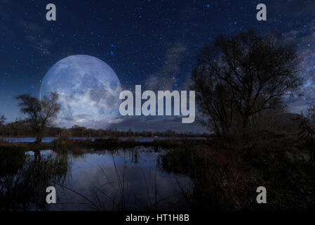 Night landscape with the Moon over the Dnieper river in Kiev, Ukraine, during autumn. Elements of this image furnished - Stock Photo
