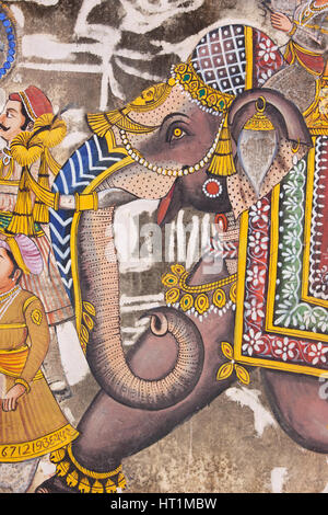 Depiction of an elephant from a piece of wall art in the center of Udaipur, India, displaying a level of detail - Stock Photo